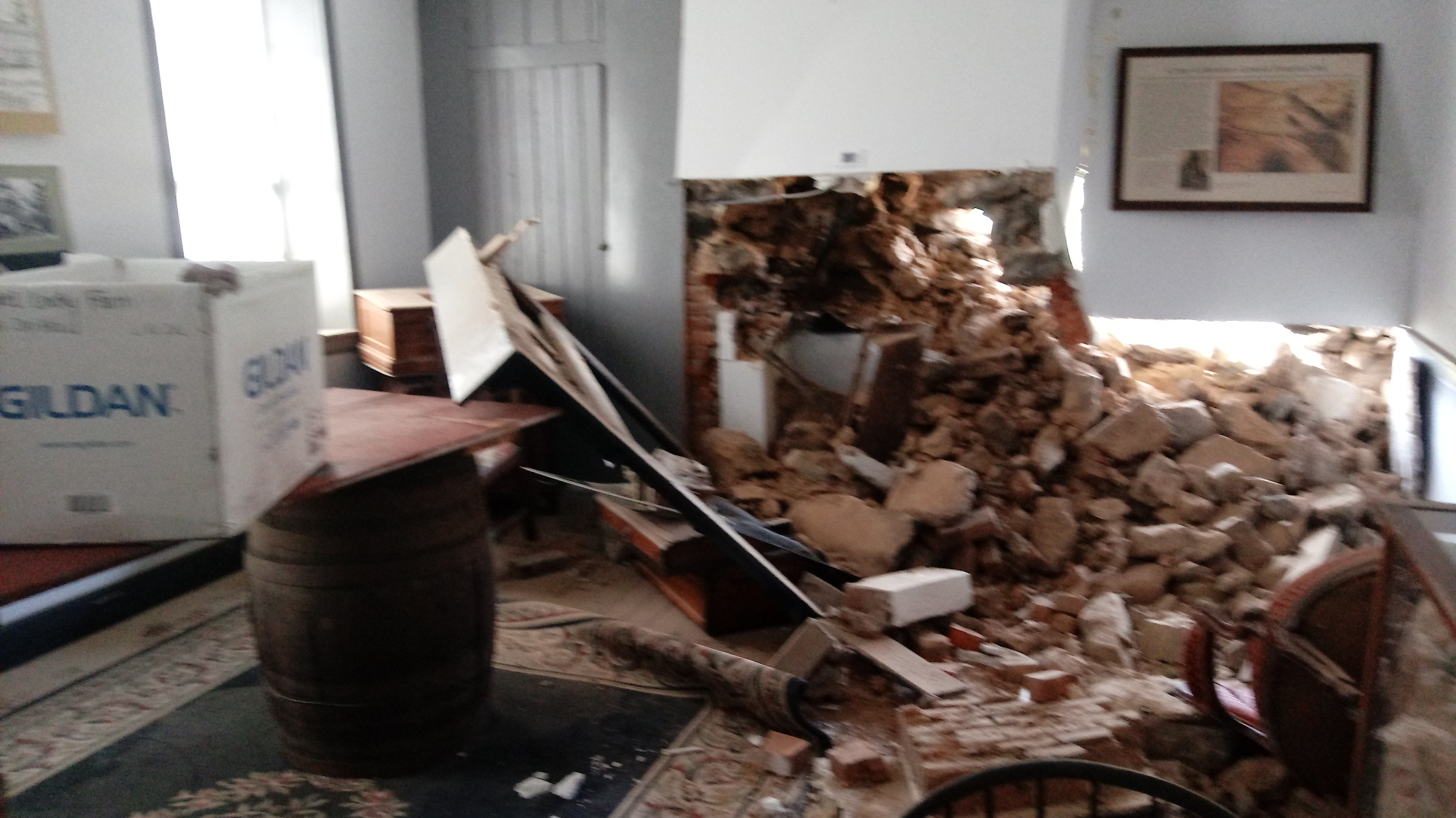 Damaged front sitting room of the Daniel Lady farmhouse after the truck was removed.
